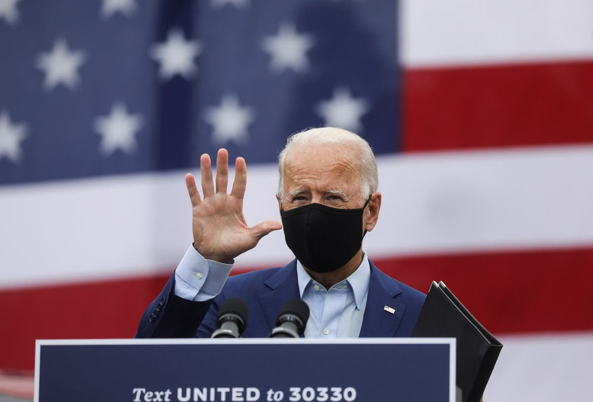 Democratic US presidential nominee Joe Biden waves at a campaign event in Michigan, Sept. 9, 2020. (Reuters)