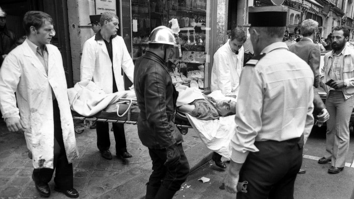rried away on a stretcher from the scene of a terror attack at Jewish restaurant and deli Jo Goldenberg in Paris, France, on August 9, 1982. (AP)
