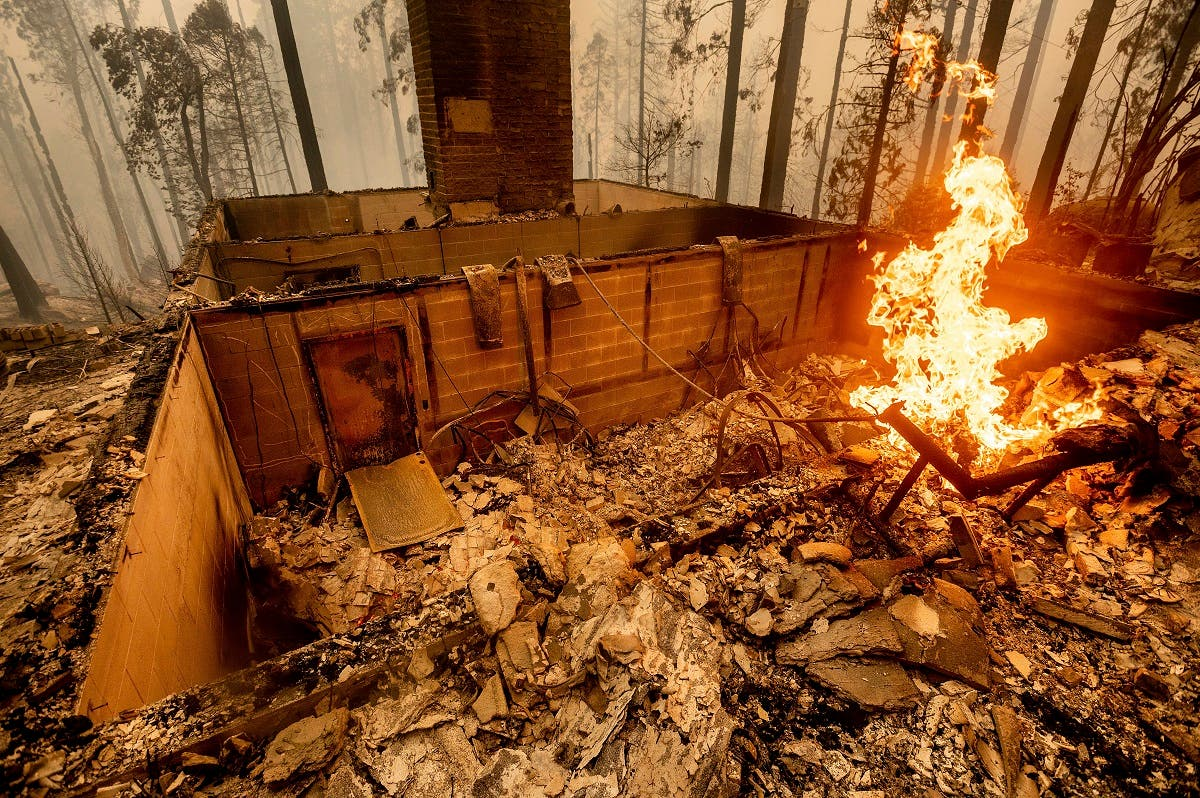 Flames burn at a home leveled by the Creek Fire along Highway 168 on, Sept. 8, 2020, in Fresno County, Calif. (AP)