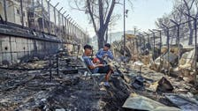 Thousands sleep in open air after fire in Greek migrant camp