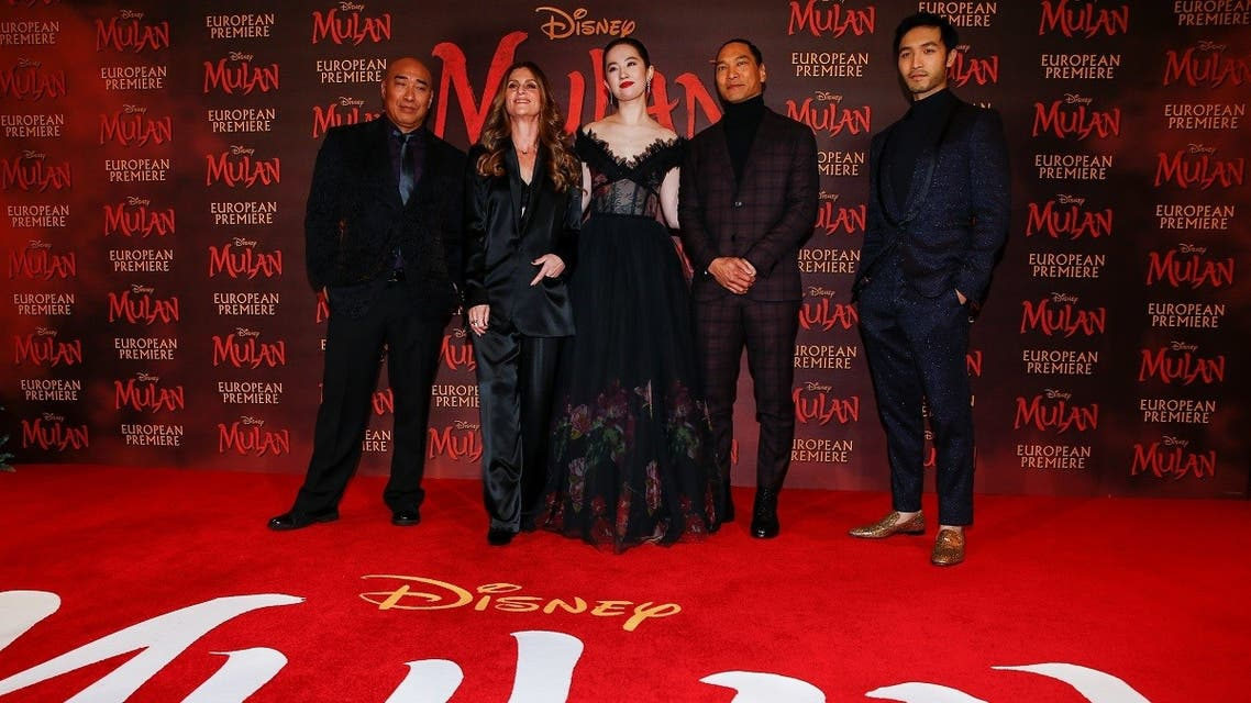 Cast members Ron Yuan, Yifei Liu, Jason Scott Lee and Yoson An pose with director Niki Caro, at the European premiere for the film Mulan in London, Britain March 12, 2020. (Reuters)