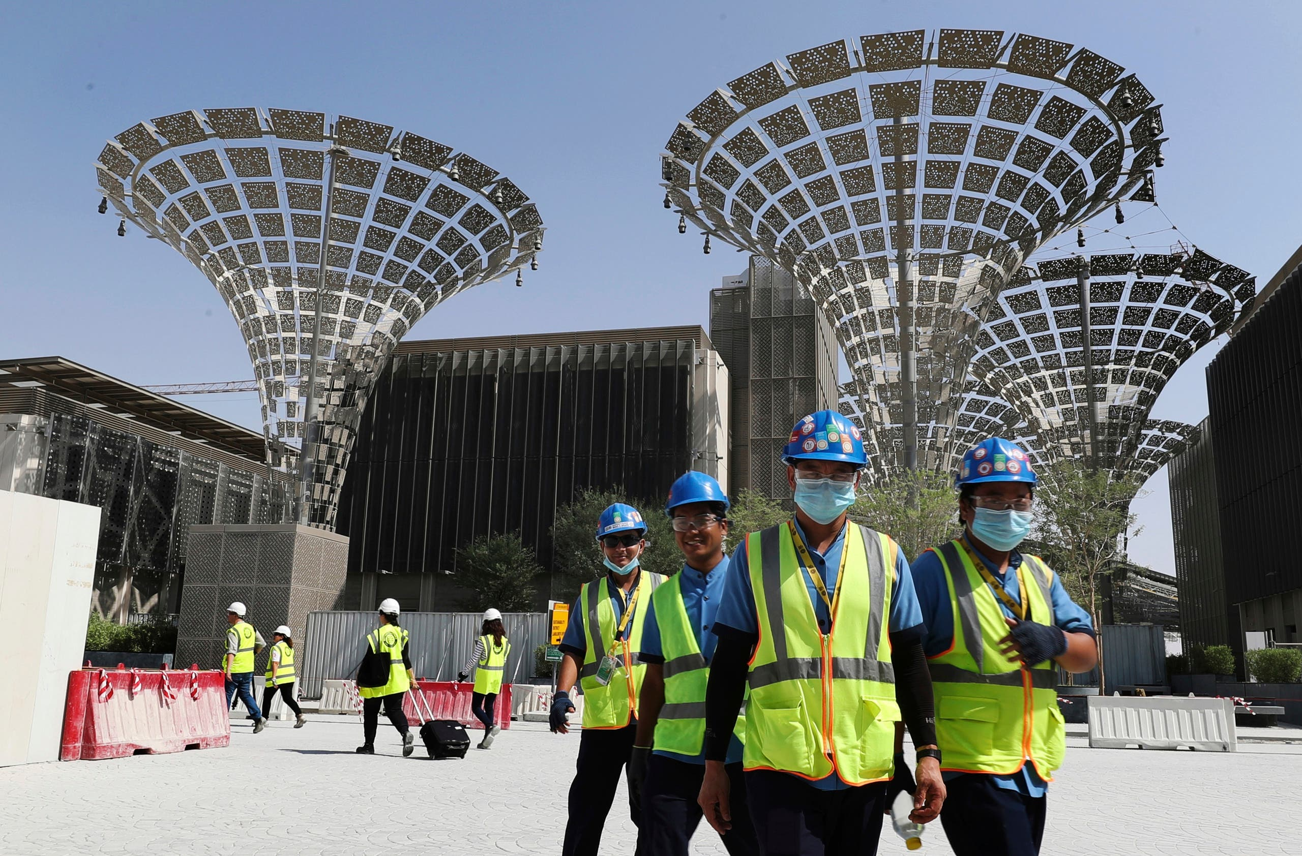 Technicians walk at the three thematic districts at the under construction site of the Expo 2020 in Dubai, United Arab Emirates. (AP)