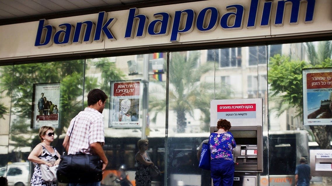 A woman uses an automated teller machine (ATM) outside a Bank Hapoalim branch in Tel Aviv, Israel May 30, 2013. (Reuters)