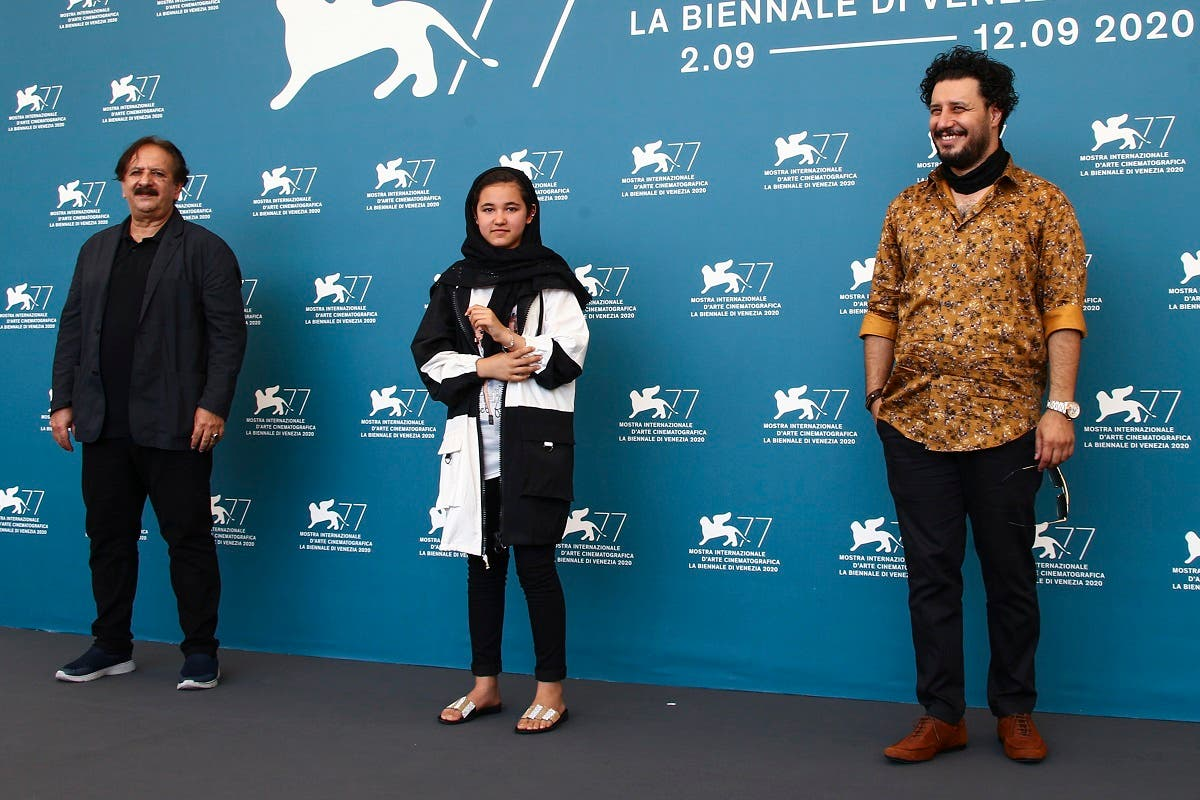 Director Majid Majidi (from left), actors Shamila Shirzad and Javad Ezati pose at the photo call for the film 'Khorshid' ('Sun Children') at the Venice Film Festival on  September 6, 2020. (AP)