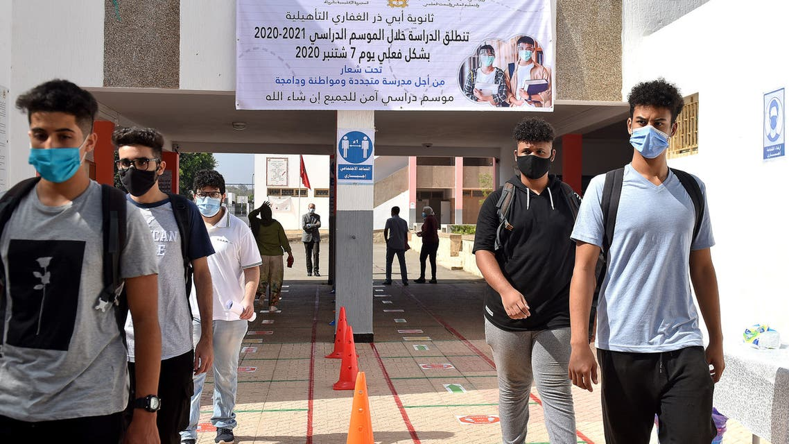 Students in Morocco arrive to school on the first day of classes amid measures put in place by Moroccan authorities in bid to stop the spread of Covid-19 on September 7, 2020. (AFP)