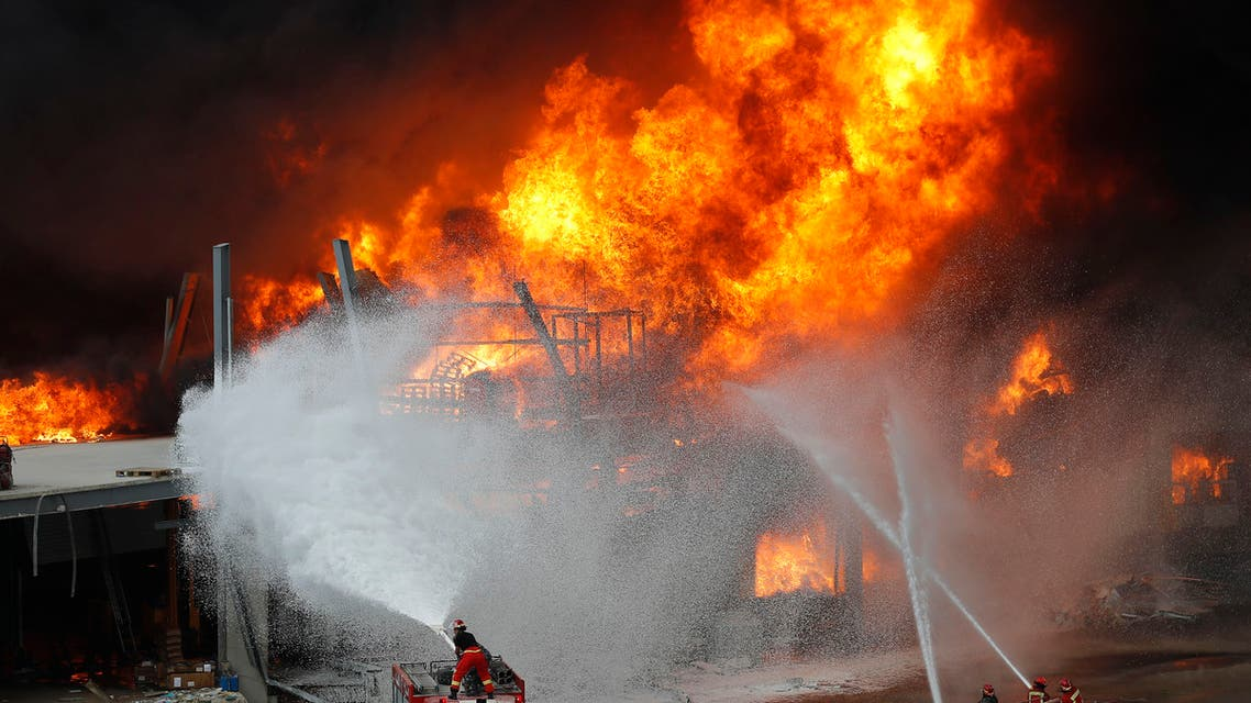 Firefighters work to extinguish a fire at warehouses at the seaport in Beirut on Sept. 10. 2020. (AP)