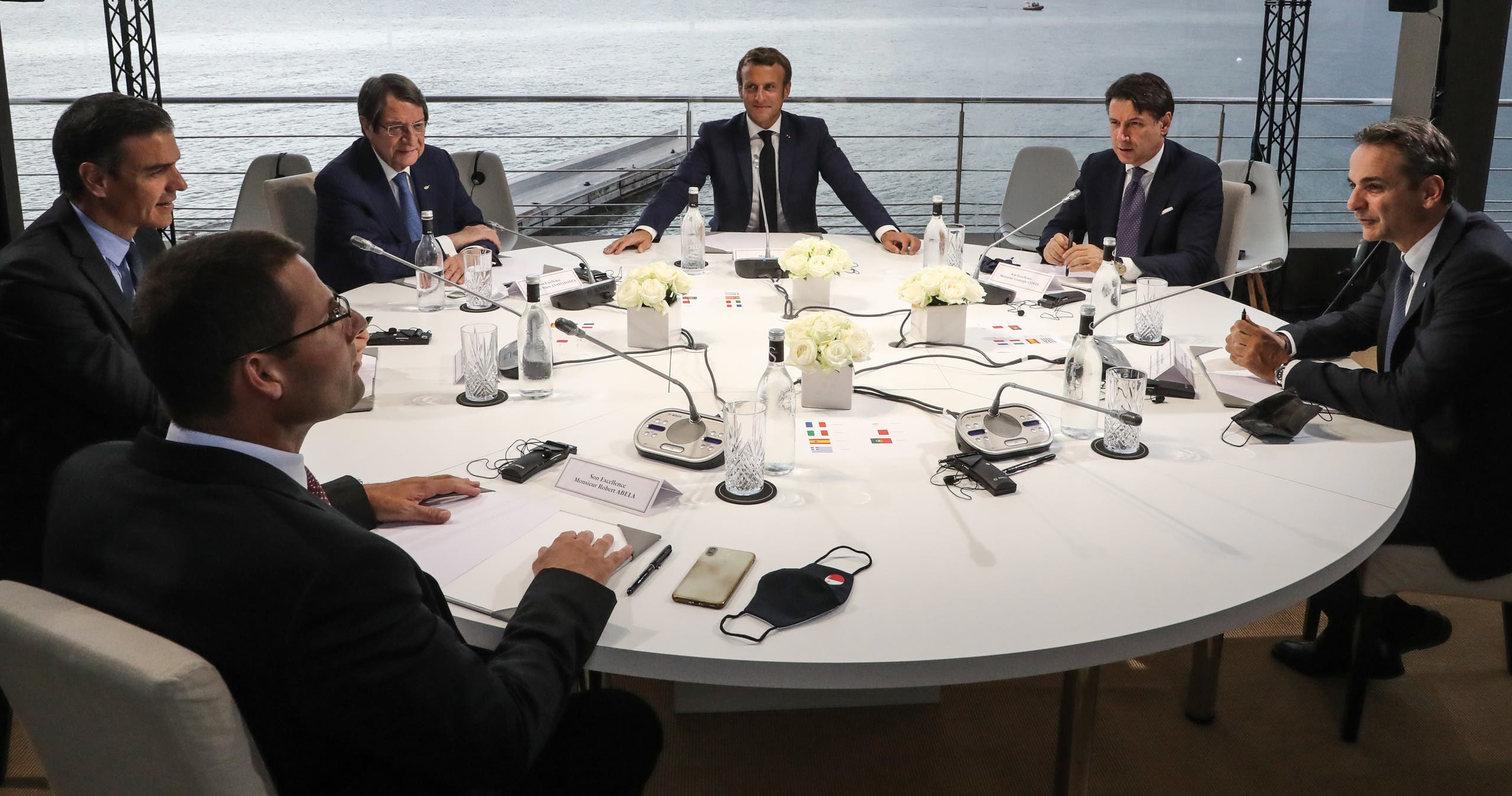 French President Emmanuel Macron (C) opens the plenary session of the seventh MED7 Mediterranean countries summit with (From L) Malta's Prime Minister Robert Abela, Spain's Prime Minister Pedro Sanchez, Cyprus President Nikos Anastasiadis, Italy's Prime Minister Giuseppe Conte and Greek Prime Minister Kyriakos Mitsotakis, on September 10, 2020 in Porticcio, Corsica. (AFP)