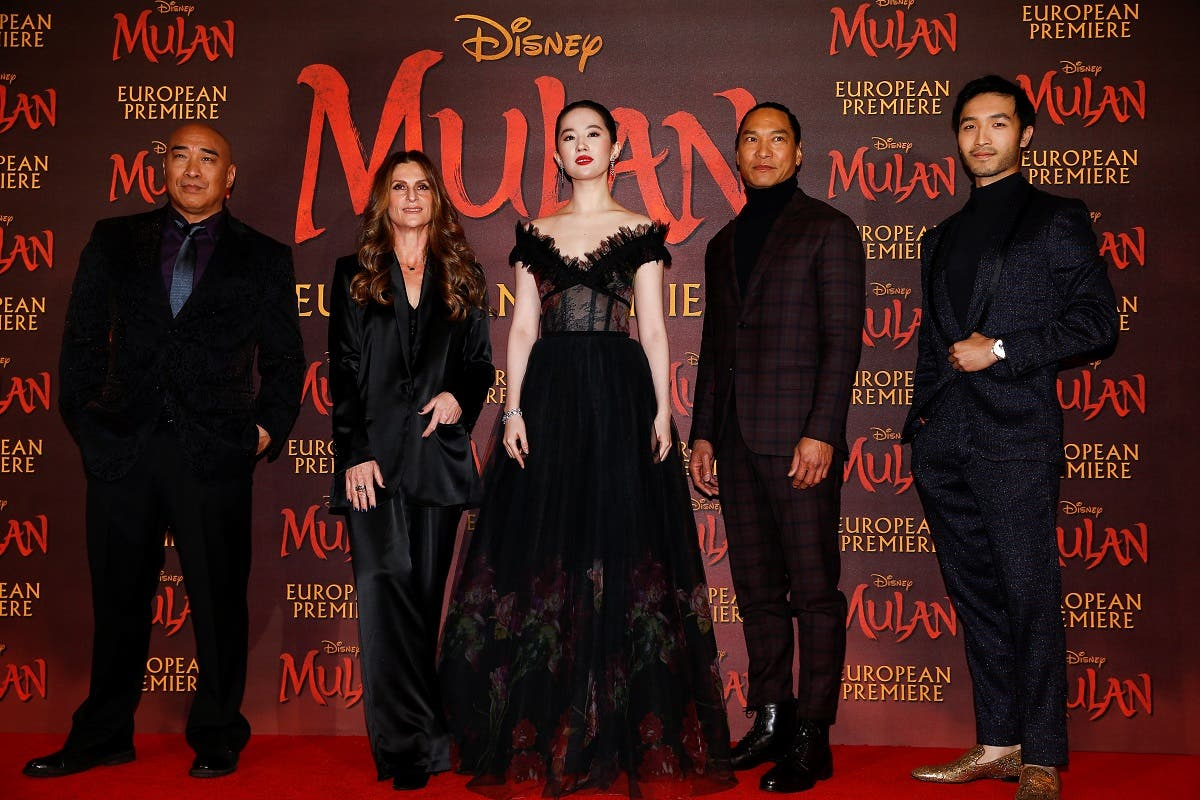 "Cast members Ron Yuan, Yifei Liu, Jason Scott Lee and Yoson An pose with director Niki Caro, at the European premiere for the film ""Mulan"" in London, Britain, on March 12, 2020. (Reuters)"