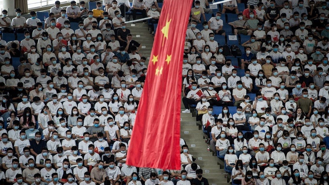 The Chinese national flag hangs from the ceiling as students sit at the Huazhong University of Science and Technology in Wuhan, Sept. 4, 2020. (AFP)