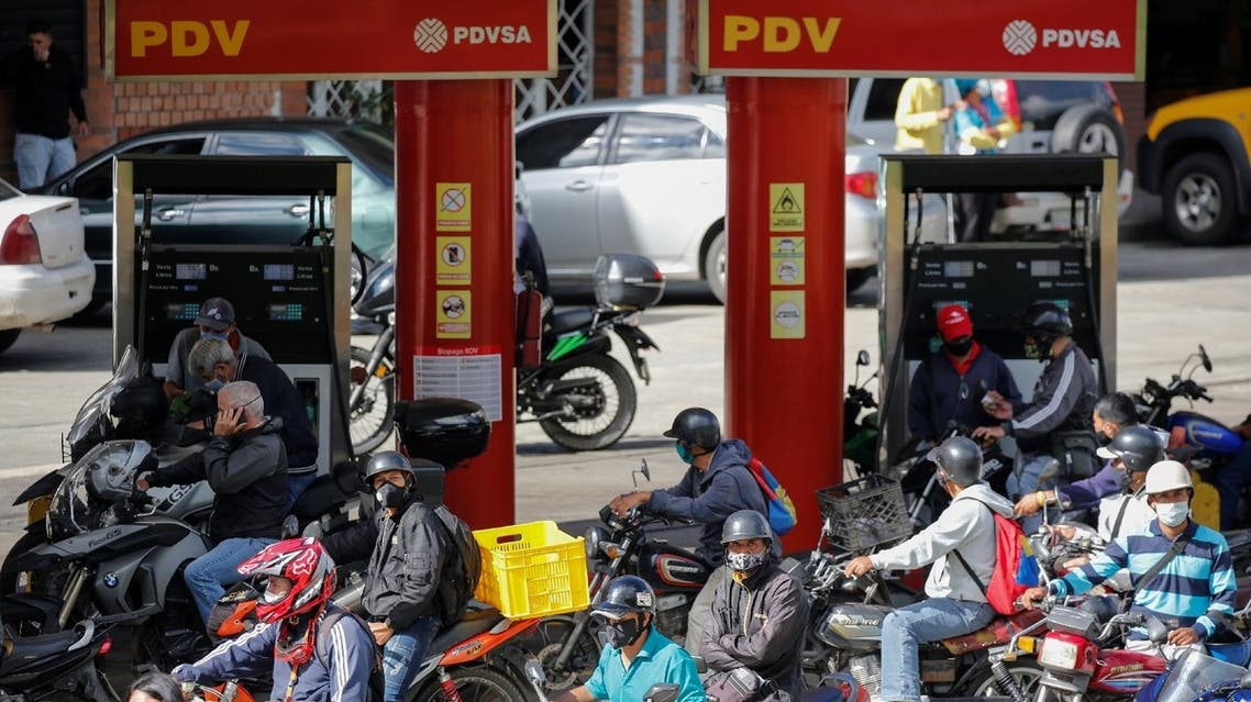 People on motorcycles refill gasoline at a gas station in San Antonio, near Caracas, Venezuela, September 9, 2020. (Reuters)