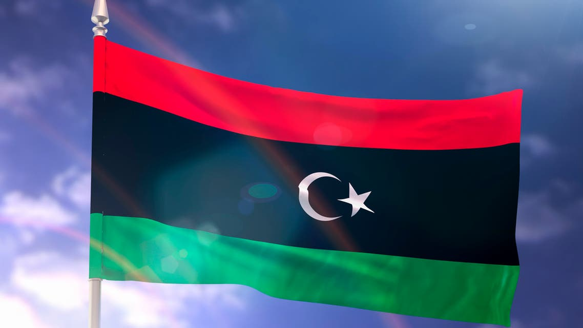 Flag of Libya with flare and dark blue sky stock photo