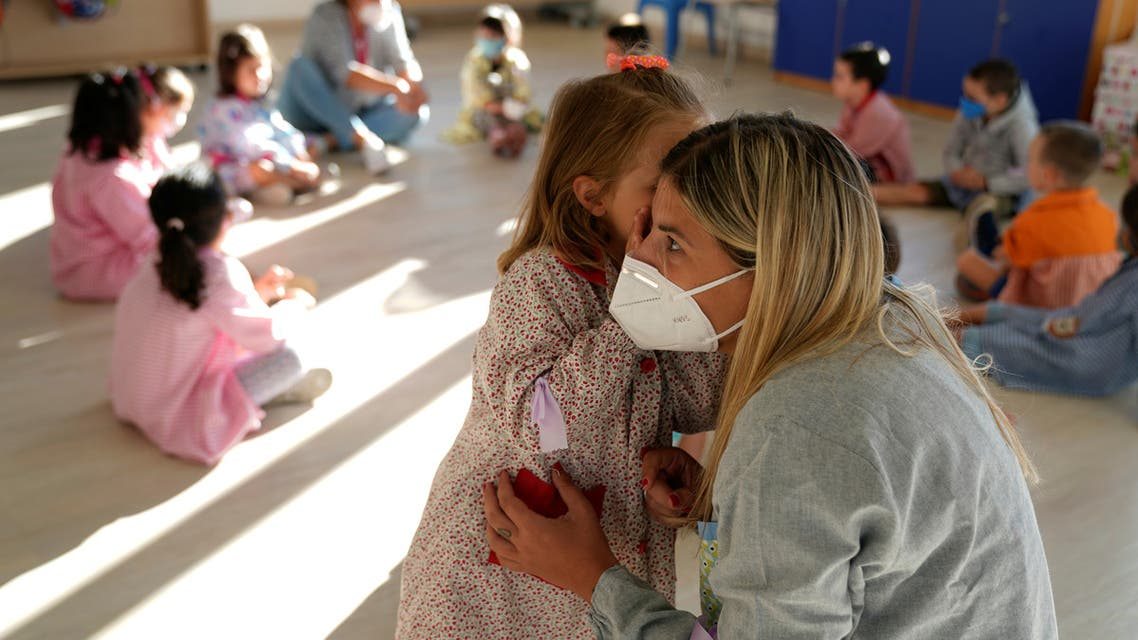 A teacher listens to a pupil on the first week of school after the summer holidays during the coronavirus disease (COVID-19) outbreak, at Larramendi Ikastola in Mungia. (Reuters)