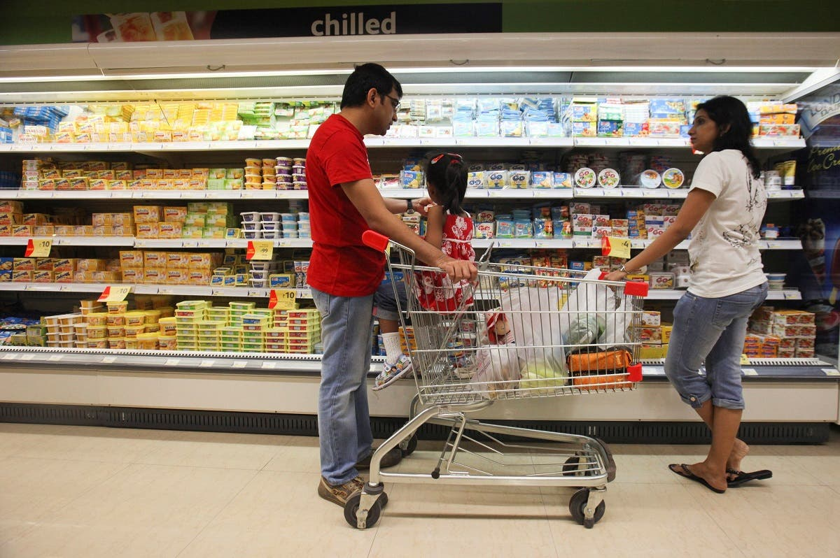Shoppers in the chilled foods section of a Reliance Fresh supermarket in Mumbai. (Reuters)