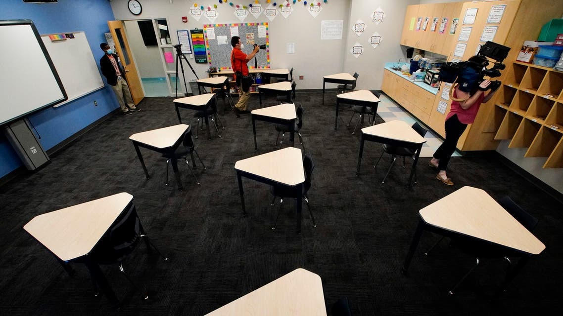Media members document the inside of a fifth grade classroom set up for social distancing at A.J. Whittenberg Elementary School of Engineering on July 20, 2020, in Greenville, S.C. (AP)