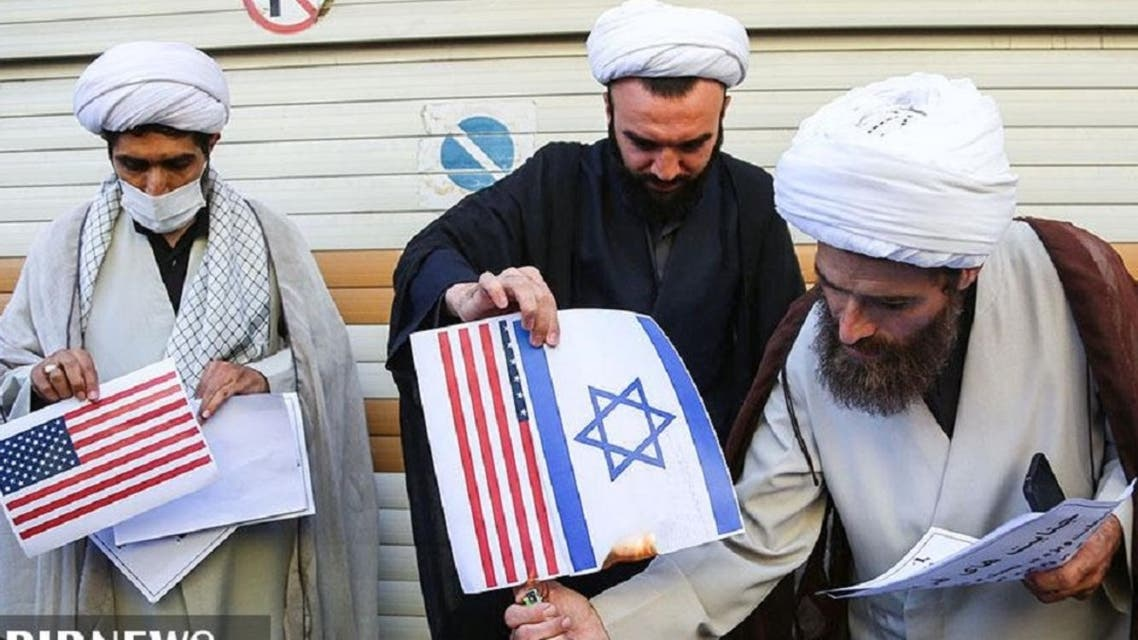Iranian clerics burn pictures of the US and Israeli flags, in Qom, Sept. 9, 2020. (IRIB)