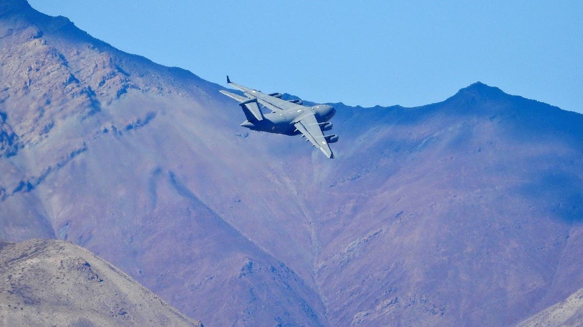 An Indian Air Force's (IAF) C-17 Globemaster transport plane flies over a mountain range in Leh. (Reuters)
