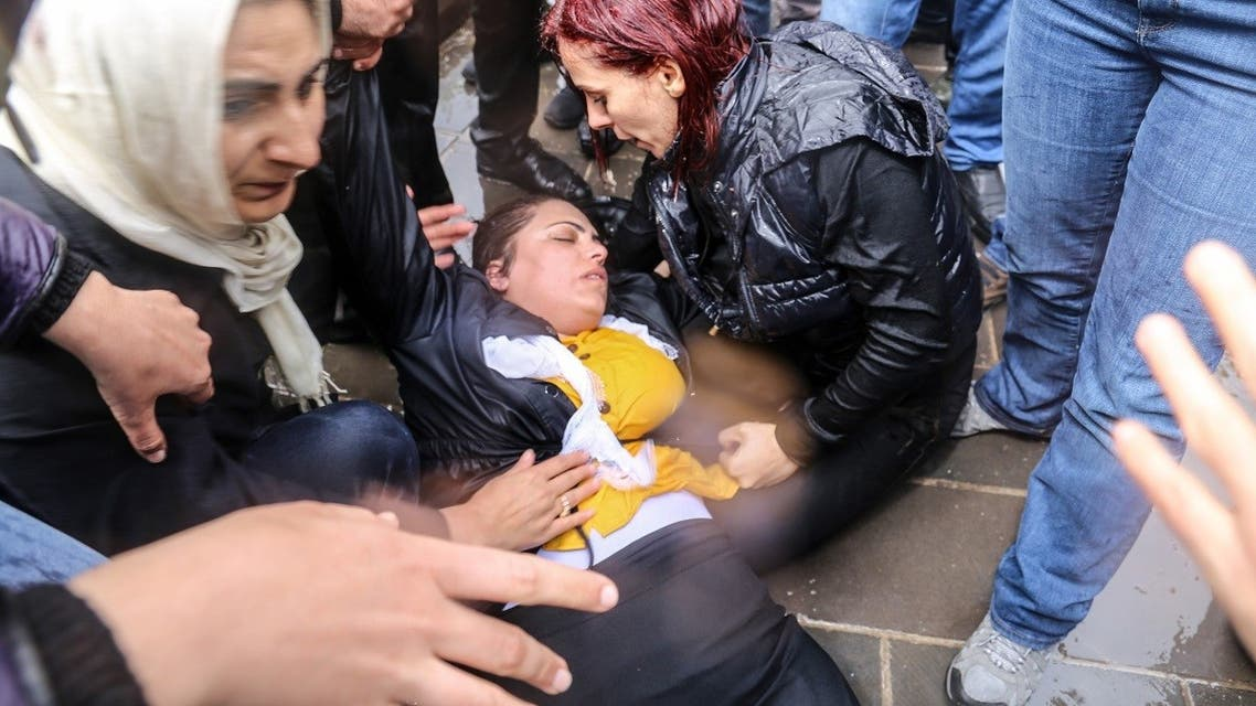 Pro-Kurdish Peoples' Democratic Party (HDP) lawmaker Remziye Tosun (C) falls after being hit by a police water cannon during a protest against results of the local elections, in Diyarbakir, on April 17, 2019. (AFP)