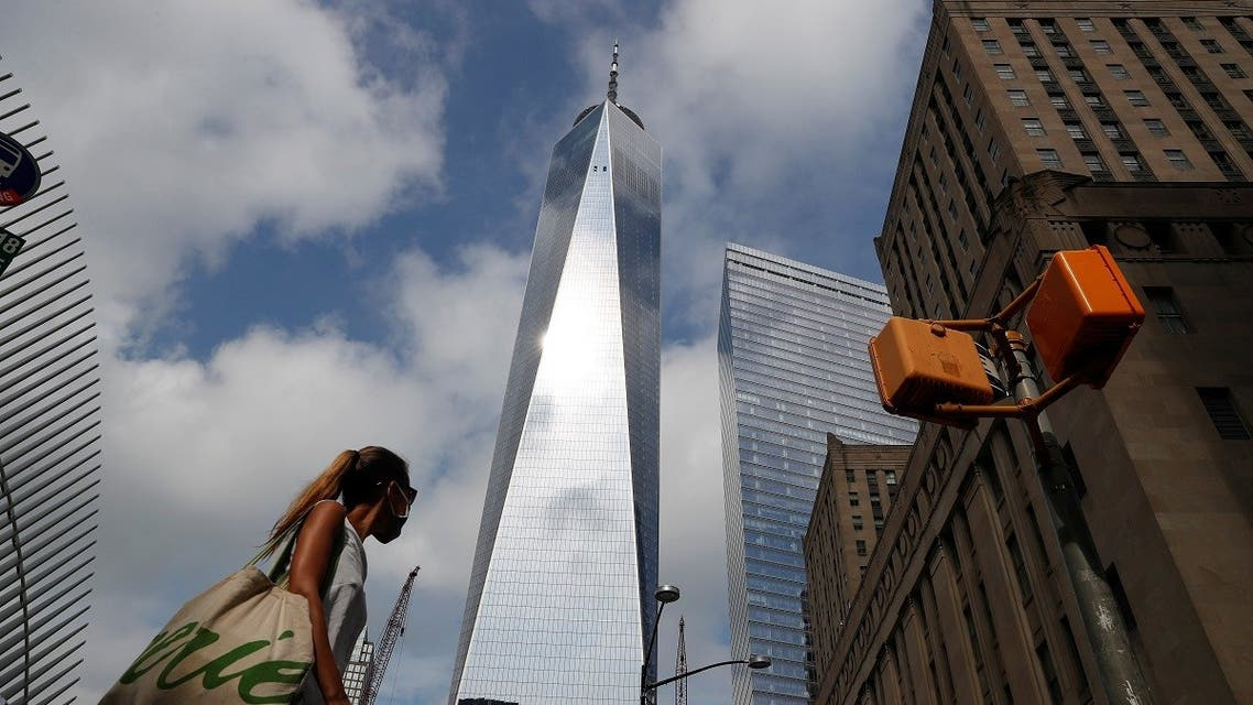 A woman wearing a protective face mask walks by One World Trade Center two days before the 19th anniversary of the 9/11 attacks, amid the coronavirus disease, in the lower section Manhattan, New York City, US, September 9, 2020. (Reuters)