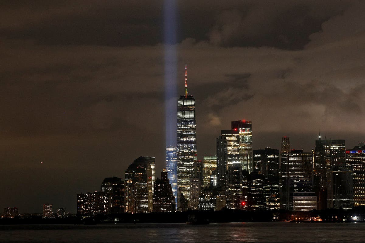 The Tribute in Light installation is tested over lower Manhattan and One World Trade Center, as seen from the borough of Brooklyn, the night before the 19th anniversary of the 9/11 attacks in New York City, US, on September 10, 2020. (Reuters)