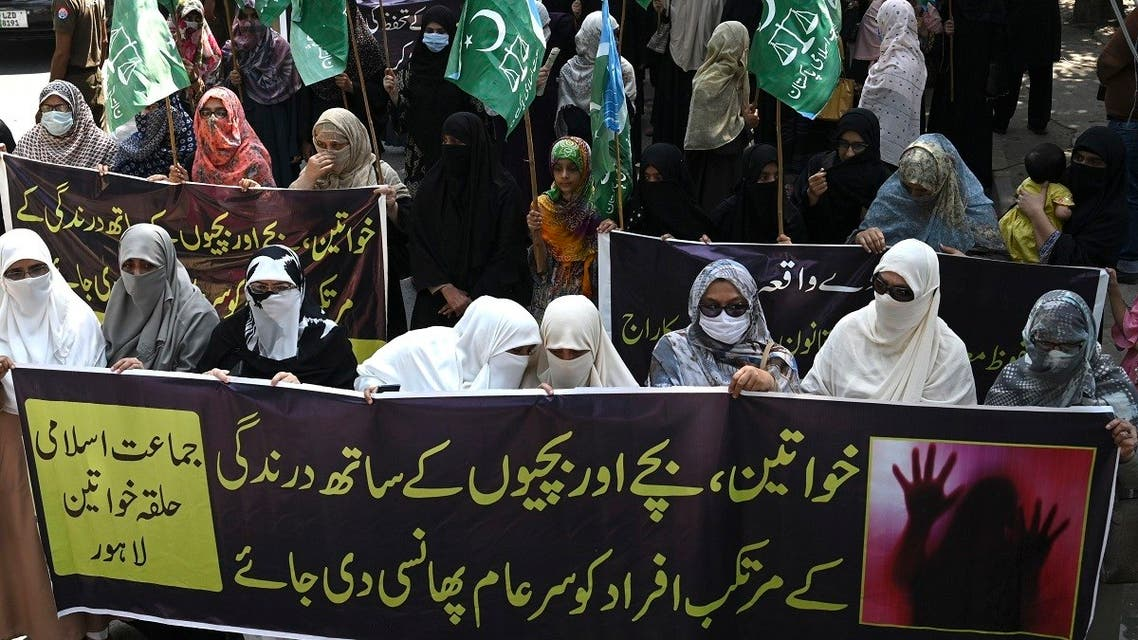 Women supporters of Pakistani Islamic political party Jamaat-e-Islami (JI) carry banners as they march during a protest against an alleged gang rape of a woman, in Lahore on September 11, 2020.  (AFP)