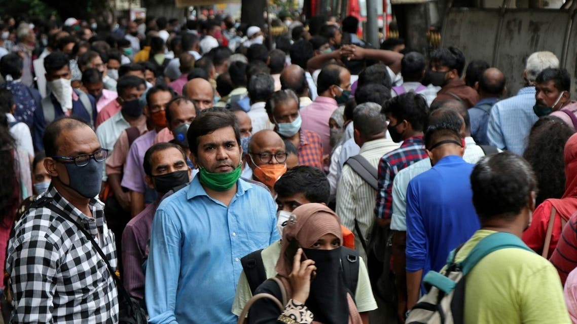 People wait to board passenger buses during rush hour at a bus terminal, amidst the coronavirus  outbreak, in Mumbai, India, on September 9, 2020. (Reuters)