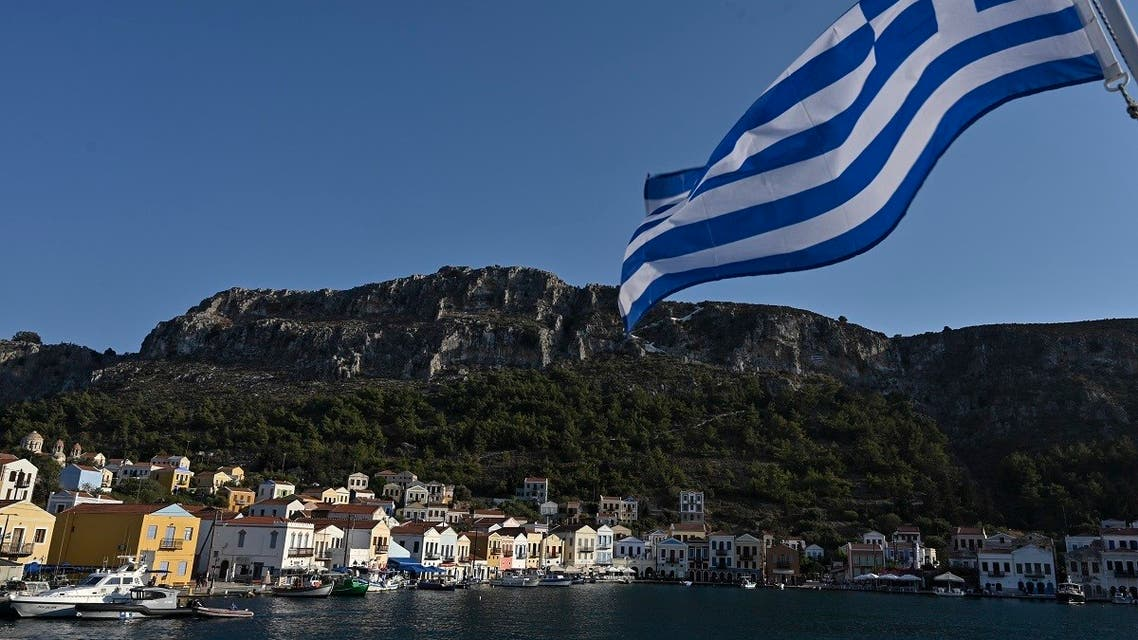 A view of the tiny Greek island of Kastellorizo (Megisti) with a Greek flag, in the Dodecanese, the furthest south eastern Greek Island, two kilometers from the Turkish mainland, on August 28, 2020. (AFP)