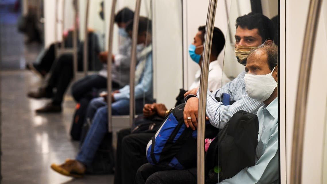 Commuters sit in a carriage of a Yellow Line train after Delhi Metro Rail Corporation (DMRC) resumed services following its closure due to the Covid-19 Coronavirus pandemic in New Delhi on September 7, 2020. India overtook Brazil on September 7 as the country with the second highest number of confirmed coronavirus cases, but authorities pressed ahead with opening up the South Asian nation's battered economy.