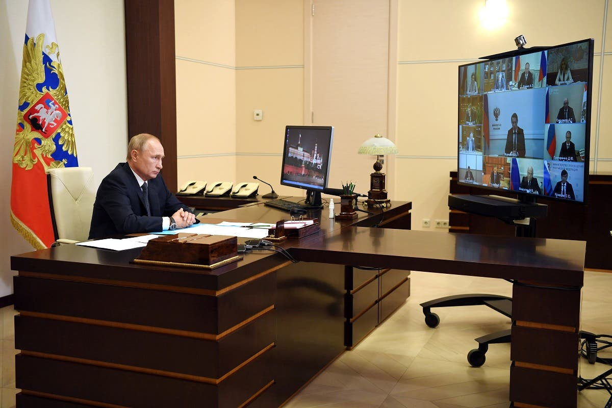 Russian President Vladimir Putin chairs a meeting with members of the government via video link at the Novo-Ogaryovo state residence outside Moscow, Russia. (Reuters)