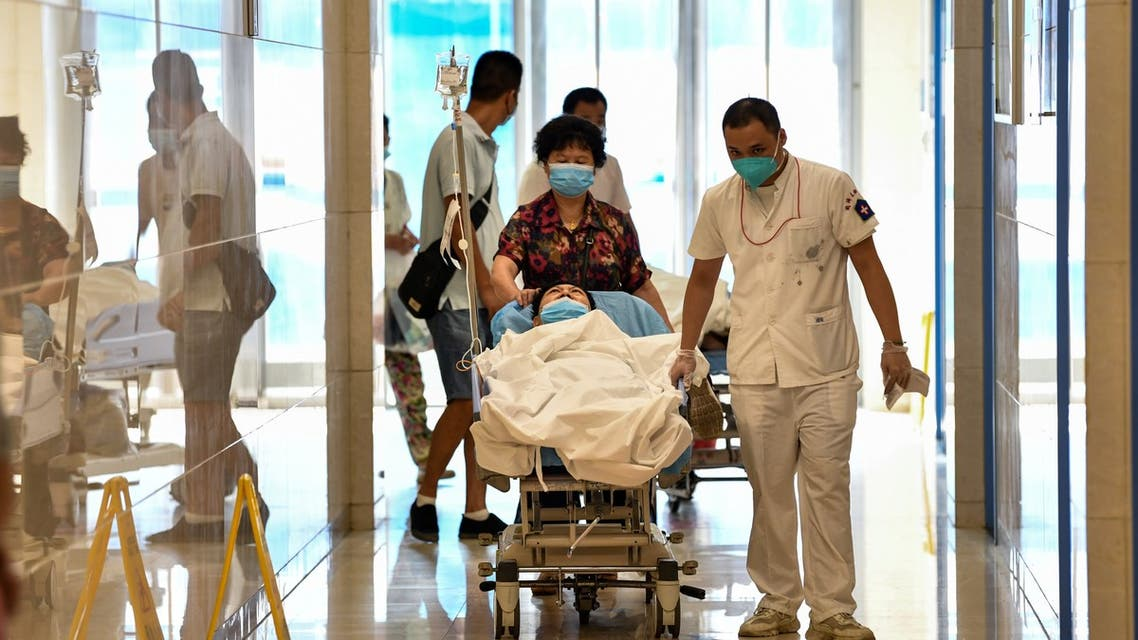 Patients and medical workers wearing face masks are seen at Tongji Hospital in Wuhan, China's central Hubei province on September 3, 2020, during a media visit to the facility organised by local authorities.