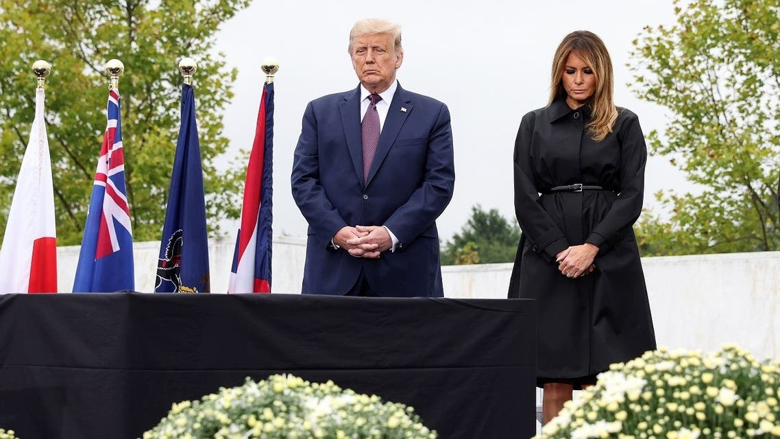 President Donald Trump and first lady Melania Trump attend a ceremony at the National Memorial, remembering those killed when hijacked Flight 93 crashed into an open field on September 11, 2001, in Stoystown, Pennsylvania, onSeptember 11, 2020. (Reuters)