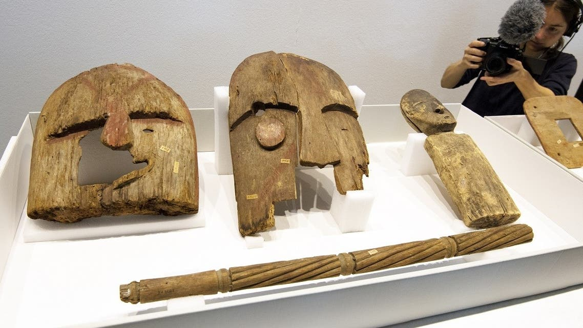 Wooden objects from Berlin's Ethnological Museum are on display during a restitution ceremony in Berlin on May 16, 2018. (AFP)