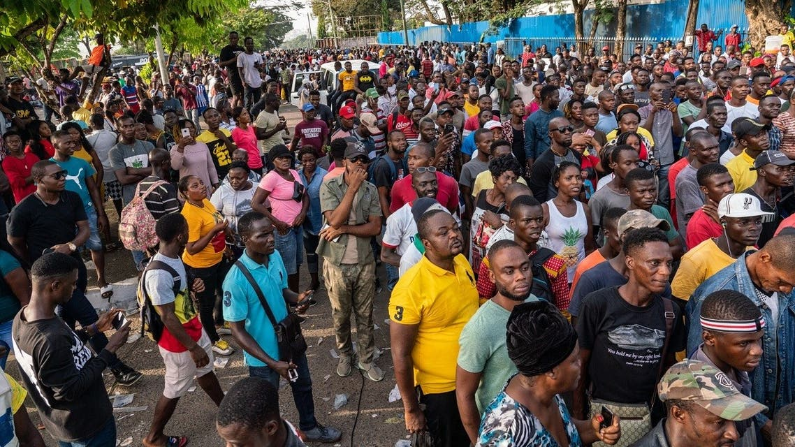 Members of the Council of Patriots (COP) gather in the streets while protesting against the deepening economic crisis under Liberian President George Weah, in Monrovia. (AFP)