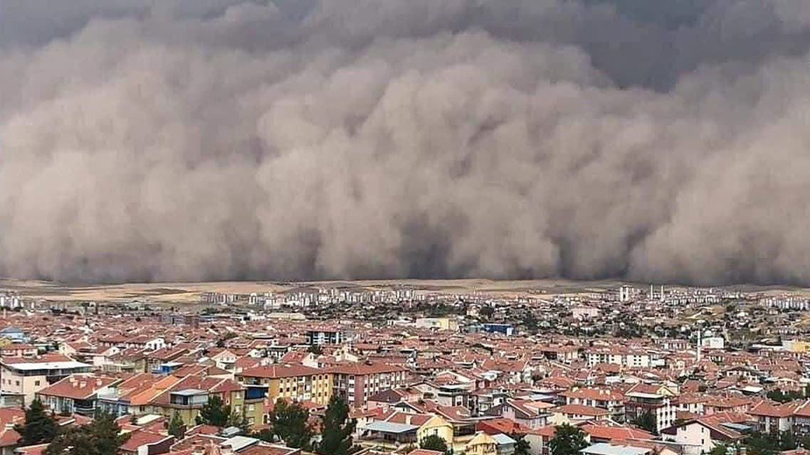 A handout TV grab made available by the Demiroren News Agency (DHA) on September 12, 2020, shows a freak sandstorm sweeping over Polatli, in Ankara. (AFP)