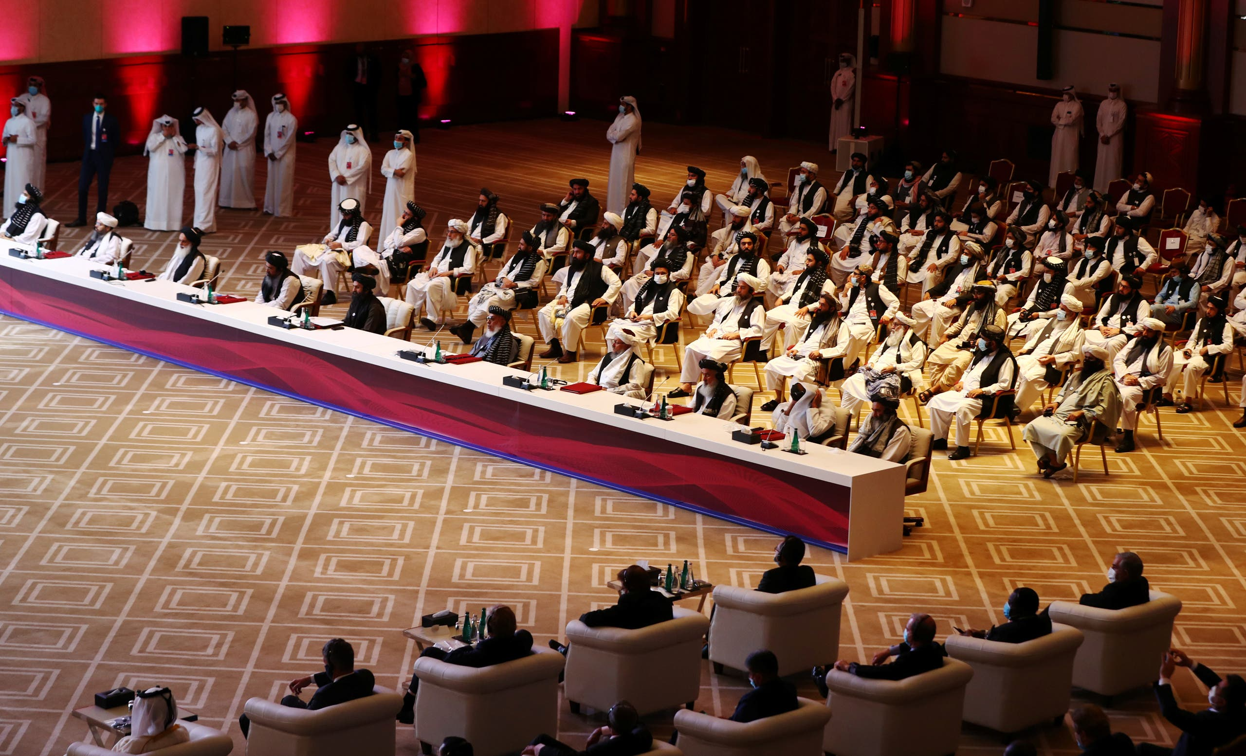 Delegates attend talks between the Afghan government and Taliban insurgents in Doha, Qatar, on September 12, 2020. (Reuters)