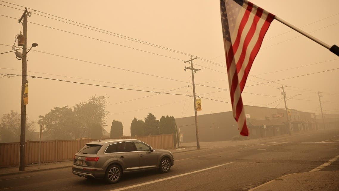 A car is seen around the town where about 10,000 residents were evacuated as the fire continues, in Molalla, Oregon, US, on September 11, 2020. (Reuters)