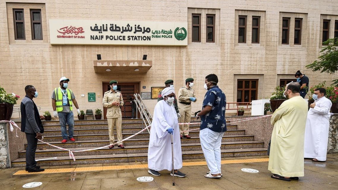 Men arriving at the police station of Naif locality queue before they are allowed to enter due to a limit on the number of persons permitted inside buildings amidst efforts to counter the COVID-19 coronavirus pandemic, in the Gulf emirate of Dubai on April 15, 2020. (AFP)