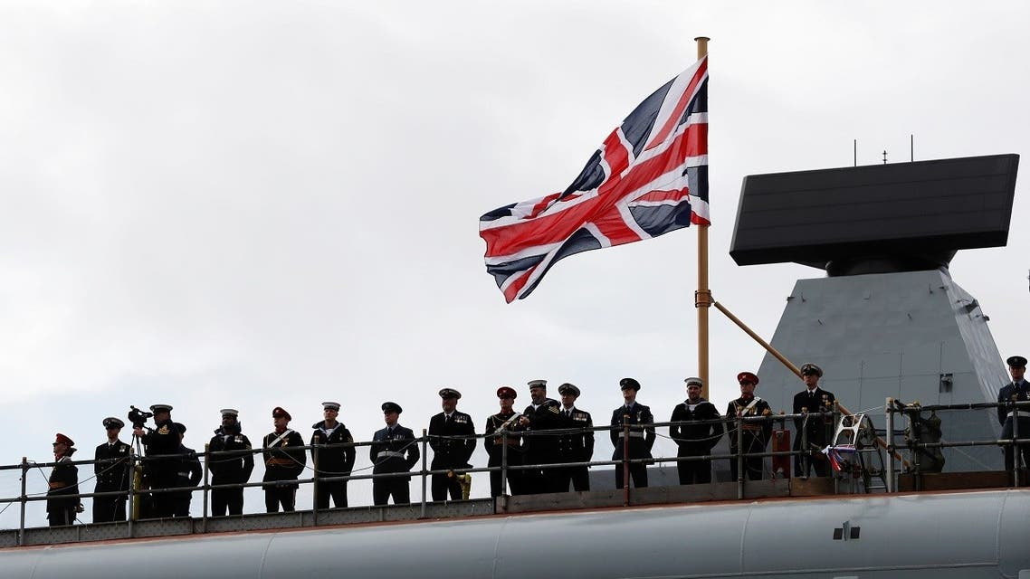Sailors stand on the deck of Britain's second new Queen Elizabeth class aircraft carrier HMS Prince of Wales, in 2017. (Reuters)