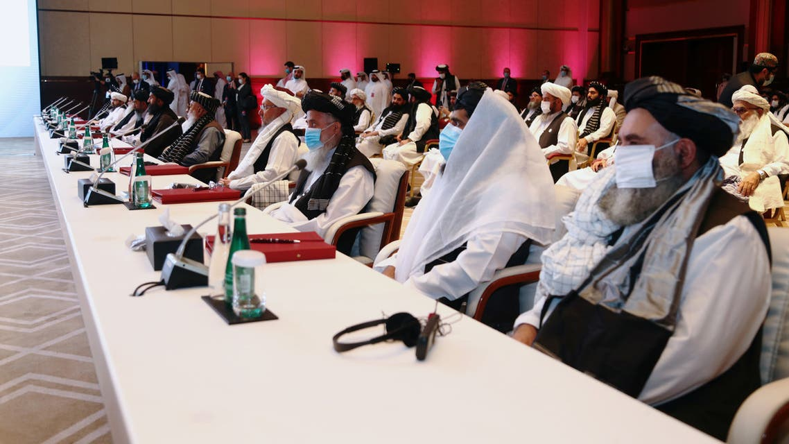 Delegates attend talks between the Afghan government and Taliban insurgents in Doha, Qatar September 12, 2020. REUTERS/Ibraheem al Omari