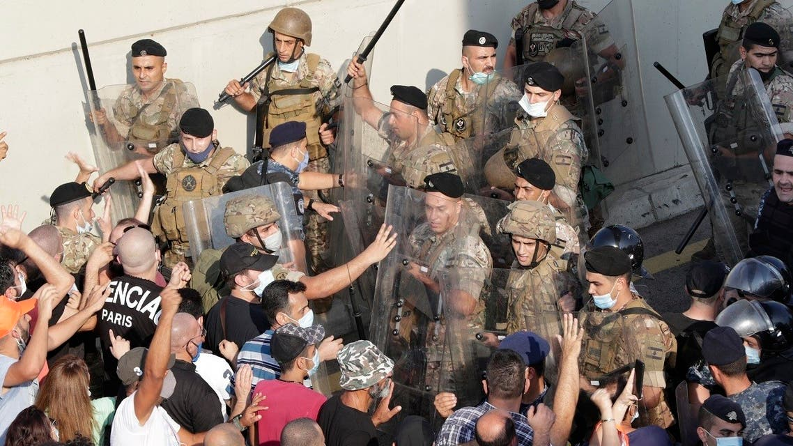 Supporters of Lebanese President Michel Aoun scuffle with security forces during a rally near the presidential palace in Baabda, east of the capital Beirut. (AFP)