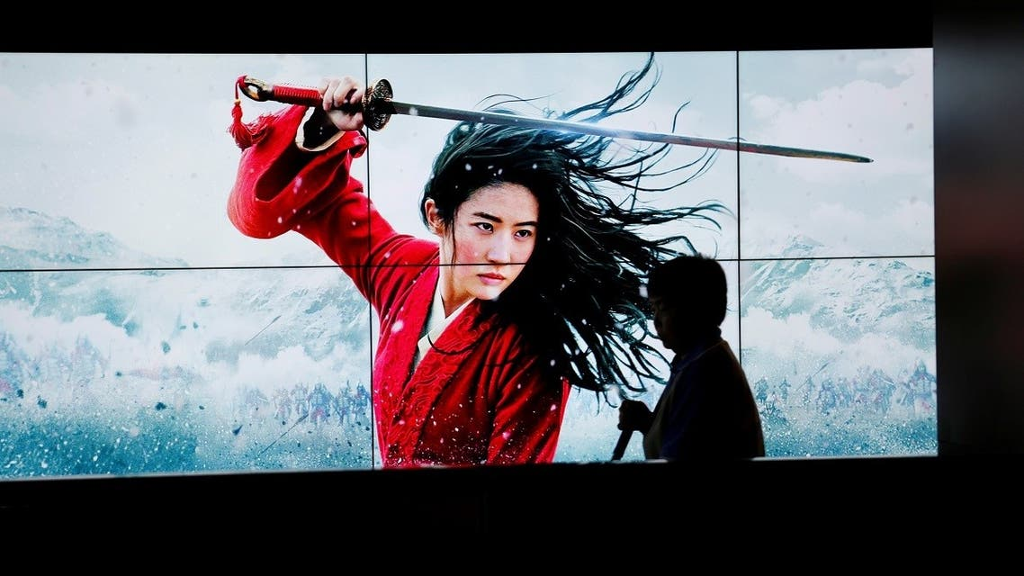 2020-09-11T0A cleaner walks past screens promoting Disney's movie Mulan as the film opens in China, at a cinema in Beijing, China, on September 11, 2020. (Reuters)35327Z_323874713_RC23WI9I0E4H_RTRMADP_3_FILM-MULAN-CHINA