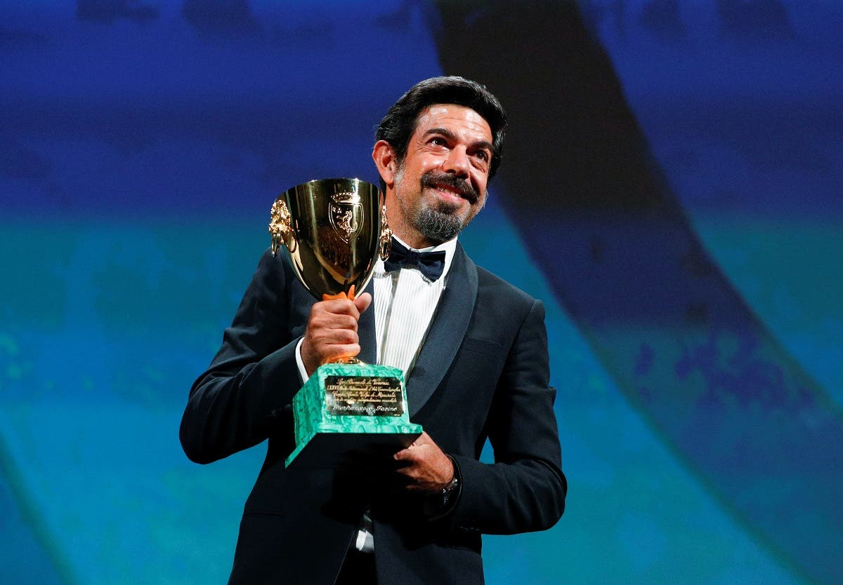 Actor Pierfrancesco Favino wins the Coppa Volpi for best actor. (Reuters)