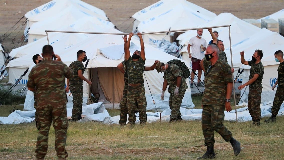 Greek soldiers set up tents at a disused shooting range to accommodate refugees and migrants from the destroyed Moria camp following a fire, on the island of Lesbos, Greece, September 11, 2020. (Reuters)