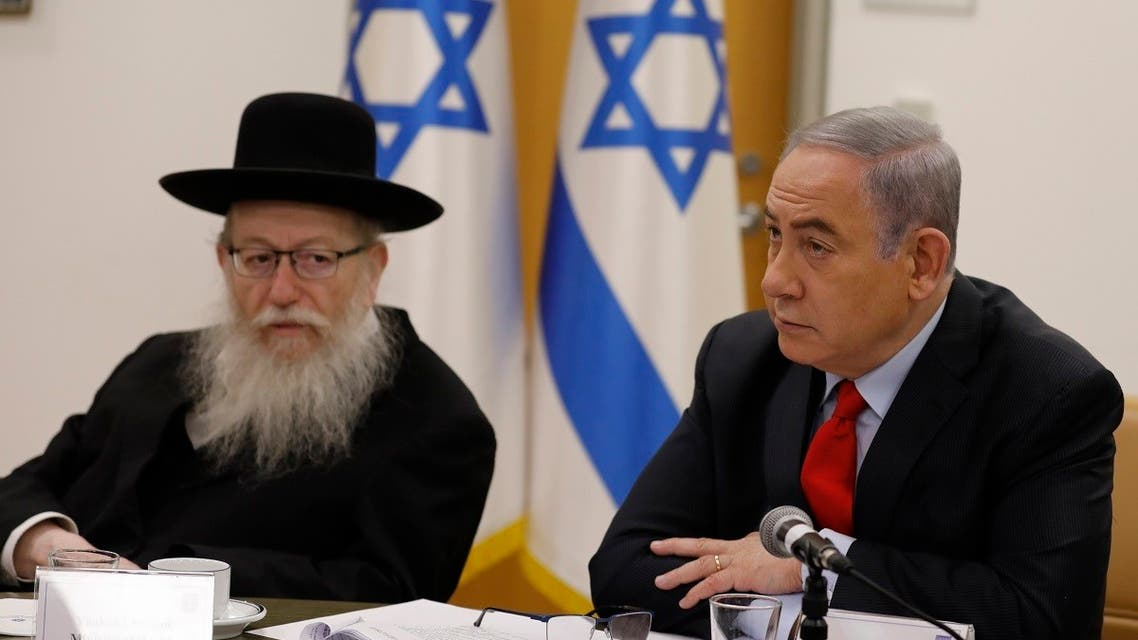 Israeli Prime Minister Benjamin Netayahu (R) and Health Minister Yaakov Litzman hold a video conference with European leaders in order to discuss challenges and cooperation between various countries in dealing with COVID-19 coronavirus, at the Foreign Ministry in Jerusalem on March 9, 2020. (AFP)