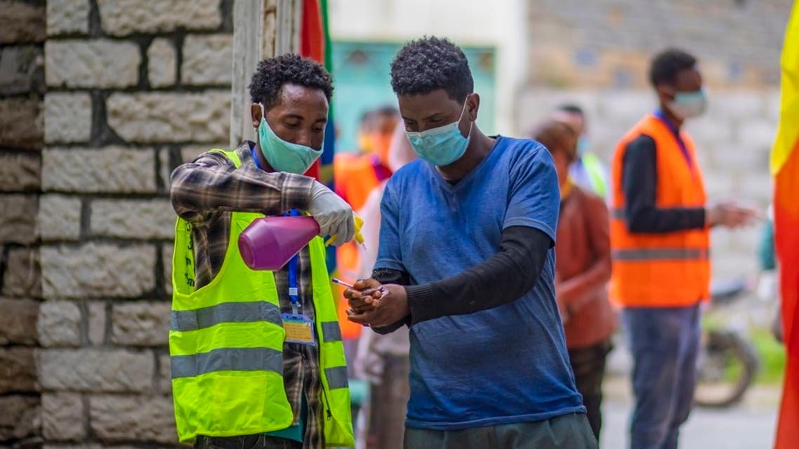 A man sanitizes his hands, to curb the spread of the coronavirus in Ethiopia. (AP)