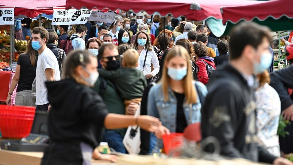 People wearing face masks, to curb the spread of Covid-19, shop at a market on September 12, 2020 in Rennes, western France. (AFP)