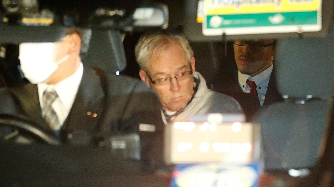 Greg Kelly, the former deputy of ousted Nissan chairman Carlos Ghosn, is seen in the car, as he leaves after being released from a detention centre in Tokyo, Japan, December 25, 2018. (Reuters)