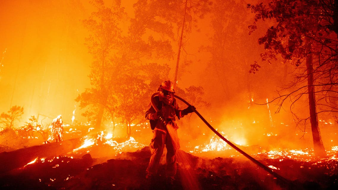 A firefighter fights to control a blaze in California, US. (AFP)
