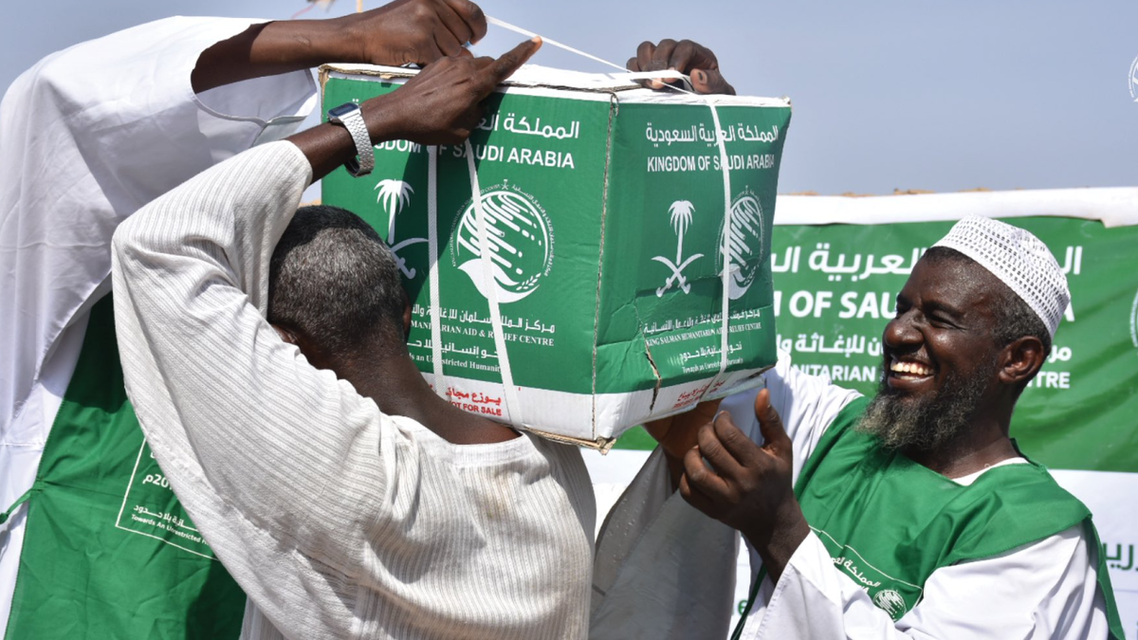 KSrelief volunteers deliver aid packages to people affected by the floods in Sudan. (Twitter)