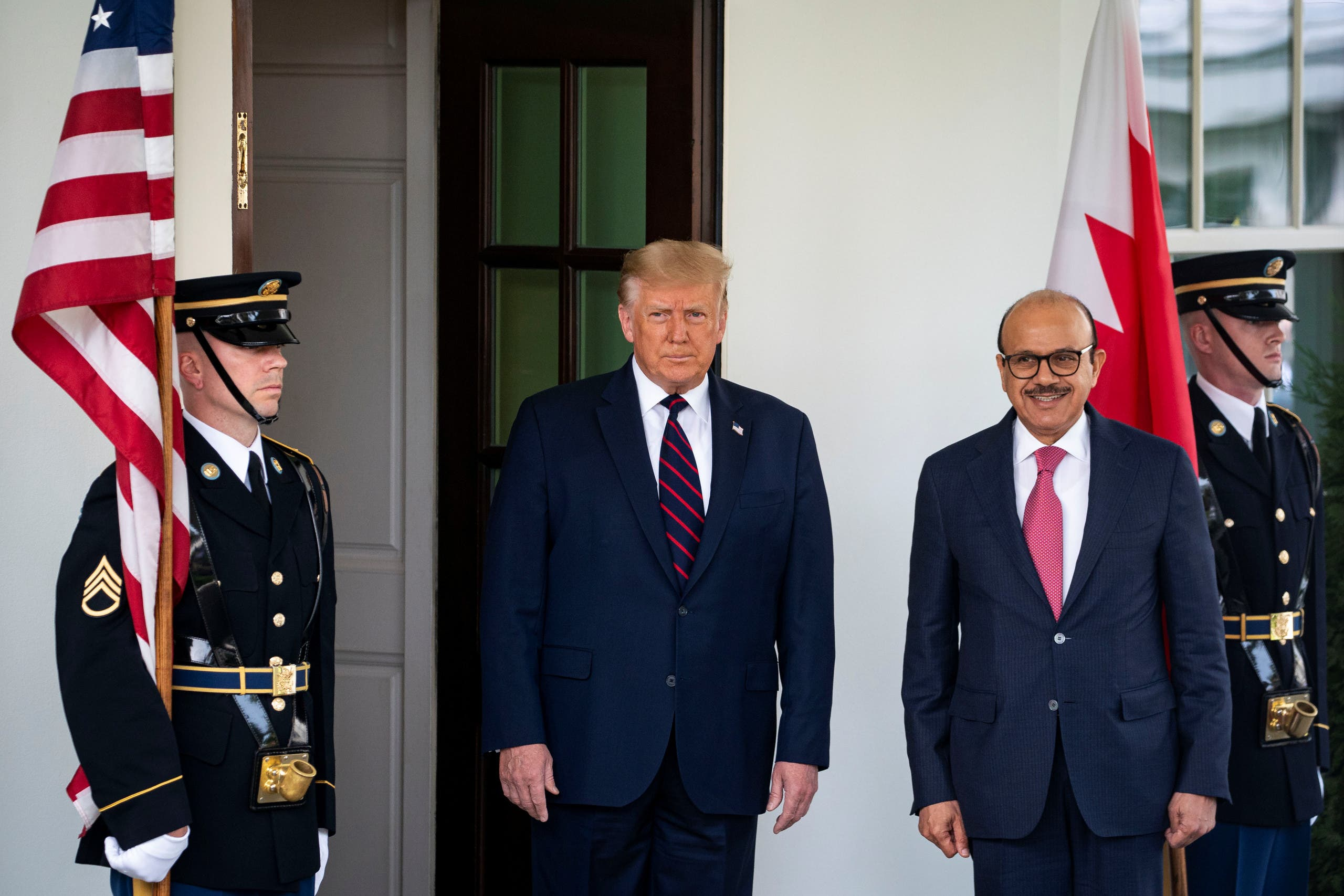 US President Donald Trump welcomes Bahrain's Foreign Minister Abdullatif bin Rashid Al Zayani at the White House in Washington on September 15, 2020. (Reuters)