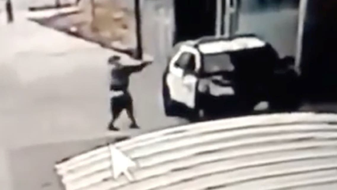 A man aims at a police vehicle in Compton, California, Sept. 12, 2020 in this still image taken from a video tweeted by the LASD. (Reuters)